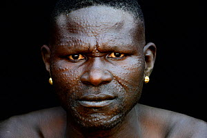 Toposa tribe man with elaborate facial skin scarifications, Omo Valley, Ethiopia, March 2015. - Eric Baccega
