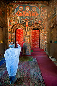 Old Ethiopian man praying (making the cross sign with his hand) inside Debre Birhan Selassie (Trinity and Mountain of Light) Church in the outskirts of Gondar, Amhara Region, Semien Gondar Zone, Ethio...  -  Constantinos Petrinos