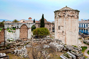 Tower of the Winds or the Horologion of Andronikos Kyrrhestes, with  Cypress Tree (Cupressus sempervirens), and the Fethiye Mosque among the ruins of the Roman Agora. Athens, Greece, Mediterranean, Ja... - Constantinos Petrinos