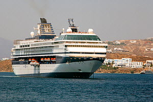 Cruise ship from 'Celebrity Cruises' anchored outside Mykonos Town since it is unable to enter the harbor due to its size. Mykonos Island, Cyclades, Aegean Sea, Mediterranean, Greece, August 2007. - Constantinos Petrinos