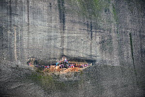 Meteora rock near to village of Kastraki. The scarves are hung at the entrance to the cave. Every year, on St. George's day, people climb the rock and hang new scarves that will stay there for a year... - Constantinos Petrinos