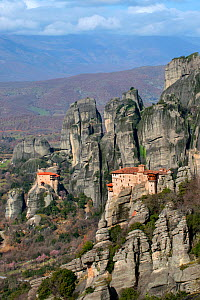 Two Greek Orthodox rock Monasteries  in Meteora. The Holy Monastery of Rousanou/St. Barbara (foreground right, founded in the middle of 16th century) and in the background the Holy Monastery of St. Ni...  -  Constantinos Petrinos