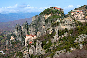 Four Greek Orthodox Rock Monasteries  in Meteora. The Holy Monastery of Rousanou/St. Barbara (foreground right) founded in the mid 16th century, in the background the Holy Monastery of St. Nicholas An...  -  Constantinos Petrinos