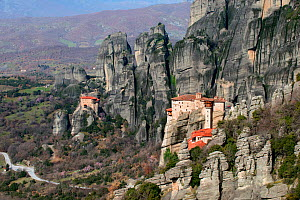 Two Greek Orthodox rock Monasteries  in Meteora. The Holy Monastery of Rousanou/St. Barbara (foreground right) which was founded in the middle of 16th century and in the background the Holy Monastery...  -  Constantinos Petrinos