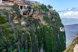 Tourist using a cable car to visit the Holy Monastery of Great Meteoron. This is the largest of the monasteries located at Meteora built in the mid-14th century. Meteora, Kalambaka, Thessaly Region, G...  -  Constantinos Petrinos