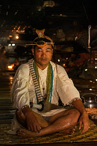 Nyshi man inside Nyshi Long House, Nyshi Tribe, Arunachal Pradesh.North East India, November 2014. - Pete Oxford