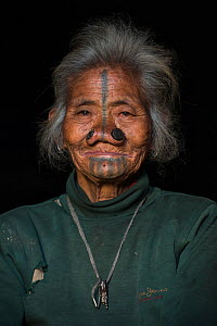 Apatani woman & facial tattoos & nose plugs / Yapin Hulo.These plugs are made of a cane slice. This practice was to make them look unattractive to males from other tribes. These facial modifications a...  -  Pete Oxford