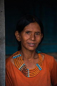 Konyak Naga woman with traditional dress and jewellry. Mon district. Nagaland,  North East India, October 2014.  -  Pete Oxford