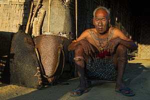 Konyak Naga tattooed head hunter. Only someone who has killed and taken a human head can be tattooed in this manner. Mon district. Nagaland,  North East India, October 2014.  -  Pete Oxford