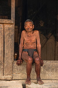 Konyak Naga elderly man wearing traditional loincloth, Mon district. Nagaland,  North East India, October 2014. - Pete Oxford