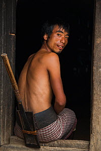 Chang Naga man with dao knife in wooden dao case attached to waist belt, Chang Naga man headhunting tribe. Tuensang district. Nagaland, North East India, October 2014.  -  Pete Oxford