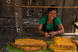 Chang Naga woman with honeycombs for sale. Tuensang district. Nagaland, North East India, October 2014.  -  Pete Oxford
