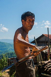 Ao Naga manwith dao knife in wooden case attached to waist belt. Chang Naga headhunting tribe. Mokokchung district. Nagaland, North East India, October 2014.  -  Pete Oxford