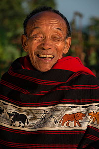 Ao Naga man in traditional shawl, Nagaland, North East India, October 2014. - Pete Oxford