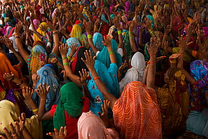 Women with hands raised at religious gathering, Bateshwar Village, Agra District, Uttar Pradesh, India, October 2014. - Pete Oxford