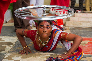 Hirja performer, balancing bicycle wheel on head, Hijra are transgender people, legally recognized as a third gender in India.  Uttar Pradesh, India, October 2014.  -  Pete Oxford