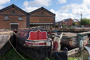Canal boats undergoing restoration in permanent mooring at Ellesmere Port Boat museum. Cheshire, UK, September 2015. - Norma  Brazendale