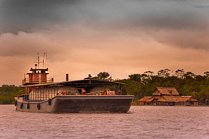 Amazon Gas tanker on the Rio Nanay at dusk, where it joins the Amazon, Iquitos, Peru, October 2014. - Mark  Bowler