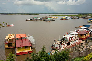 Floating petrol stations on the confluence of the River Itaya and River Amazon, Iquitos, Peru, November 2014. - Mark  Bowler