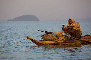 Fisherman on traditional Nile grass boat, Lake Tana Biosphere Reserve, Ethiopia. December 2013.  -  Bruno D'Amicis