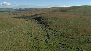 Aerial view tracking up the River Swincombe, Dartmoor National Park, Devon, England, UK, October 2015.  -  Andrew Cooper