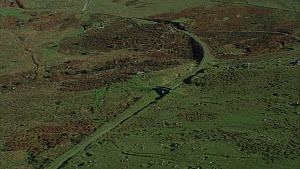 Aerial view tracking over West Moor, with a disused railway line, Dartmoor National Park, Devon, England, UK, October 2015. - Andrew Cooper