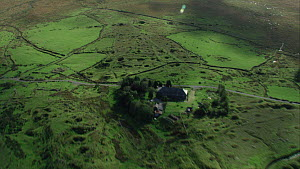Aerial view tracking over Whiteworks hamlet, showing evidence of past mining, Dartmoor National Park, Devon, England, UK, October 2015. - Andrew Cooper