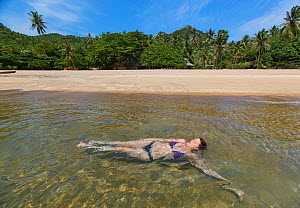 Woman swimming in  Tanote Bay, Koh Tao, Gulf of Thailand, Thailand, October 2013. Model released. - Matthew Maran