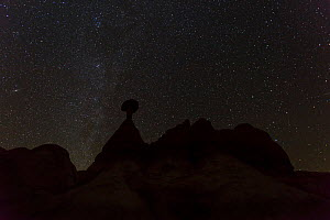 Toadstool shaped hoodoo silhouetted against sky at night, Grand Staircase-Escalante National Monument, Utah, Usa, February 2015.  -  Juan  Carlos Munoz