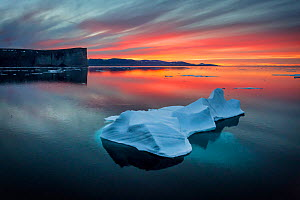 Sunset off Scott Island, with floating pieces of sea ice, Scott Inlet, Baffin Island, Canadian Arctic, August 2015. - Brent  Stephenson