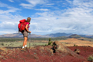 Vicky Spring hiking the wilderness trail in Craters Of The Moon National Monument, Idaho, USA, July 2015. Model released.  -  Kirkendall-Spring
