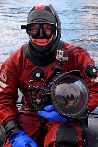 Underwater photographer, Magnus Lundgren, with his camera, ready to go swimming with whales, Senja, Troms County, Norway, Scandinavia, January 2015.  -  Wild  Wonders of Europe / Widstrand