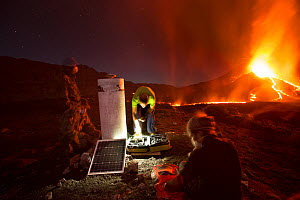 Scientists observing lava and ash plume erupting from Fogo Volcano, Fogo Island, Cape Verde, 29th November 2014. - Pedro  Narra