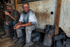 Two Charcoal burners in a shack having a break from work, Transylvania, Romania, June 2015. - Orsolya Haarberg