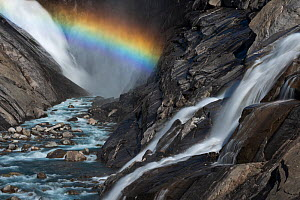 View of a rainbow in the spray of Bjornefossen Waterfall, Saltfjellet-Svartisen National Park, Norway, August 2015.  -  Orsolya Haarberg