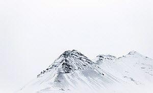 Icelandic skyline, mountain ridge covered in snow, South Iceland, October 2013. - Niall Benvie