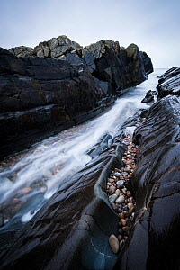 Long exposure of water rushing through inlet at, Saligo Bay, Islay, Inner Hebrides, February.  -  Niall Benvie