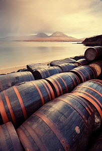 Whisky barrels at Bunnahabhain Distillery looking over to Jura, Islay, Scotland, UK, February.  -  Niall Benvie