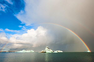 Jokulsarlon lagoon at dawn with rainbow in the sky. Iceland, October 2015.  -  Niall Benvie