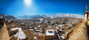 City of Leh dusted in snow with Himalaya Mountains in the background. Leh, India.  -  Wim van den Heever