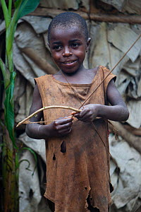 Baka child playing with bow and arrow, South East Cameroon, July 2008. - Cyril Ruoso