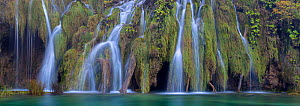 Water cascading over naturally formed tufa dam. Tufa is a kind of limestone, formed from the precipitation of carbonate minerals which builds up around mosses and water plants to form a solid limeston...  -  Alex  Hyde
