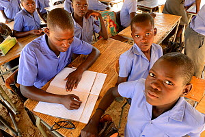 Students of different ages studying in the same class, Etanga School, Kaokoland, Namibia. October 2015 - Eric Baccega