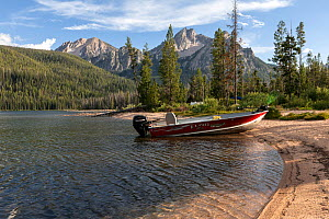 Boat beached on shore of Stanley Lake, Sawtooth National Recreation Area, Idaho, USA. July 2015.  -  Kirkendall-Spring