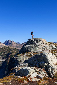 Hiker above Horsefly Pass, North Cascades National Park Complex, Washington, USA. October 2015. Model Released.  -  Kirkendall-Spring