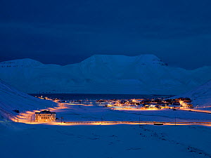 Longyearbyen town at first light, with street lamps lighting the roads,Svalbard, Norway, February.  -  Pal Hermansen