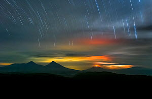 Long exposure of star trails over Virunga volcanoes seen from Bwindi Impenetrable National Park, Uganda. November  -  Will Burrard-Lucas