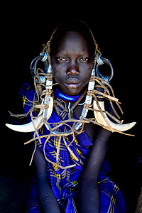 Young girl in traditional dress. Mursi tribe, Mago National Park. Omo Valley, Ethiopia.  -  Enrique Lopez-Tapia