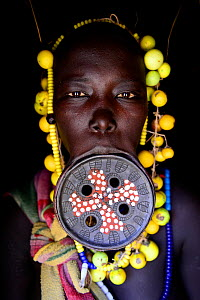 Mursi woman with large clay lip plate. Mago National Park. Omo Valley, Ethiopia. - Enrique Lopez-Tapia