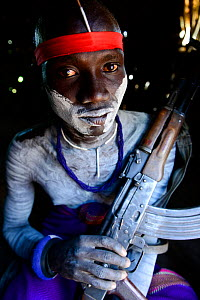 Mursi man with bodypaint,  armed with gun. Omo Valley. Ethiopia.  -  Enrique Lopez-Tapia